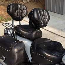 Dual all Black Vinyl with custom flame stitching, RCP built-in driver backrest with pouch and studs throughout